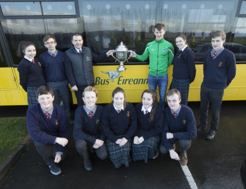 Limerick hurling star Tom Morrissey visited St John the Baptist Community School, Barrysfarm, Hospital village, Co Limerick to promote Bus Éireann's 'Go Places' competition for Transition Year Students. The competition invites TY students to share their memories of their journey to school. Deadline for entries is March 16. Tom is pictured with Pat Donnelly, Limerick Minor Hurling Manager both holding the trophy and TY students back row Anna O'Dwyer and Eoin Duncum, kneeling are Ryan McInerney, David Wolfe, Dervla Walsh, Jade Kelly and Killian Ryan. Back row on right are Leah O'Grady and Thomas Ryan.