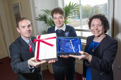 The East Winner of the Bus Éireann 'Go Places' competition for transition year students is Ruairi Meehan from Dunshaughlin Community College, Co. Meath. Pictured is Ruairi receiving his award by Adrian O'Loughlin, Bus Éireann Regional Manager and Siobhan Griffin, Bus Éireann Regional School Transport Manager for the East. Ruairi won a brand new iPad and a trophy.